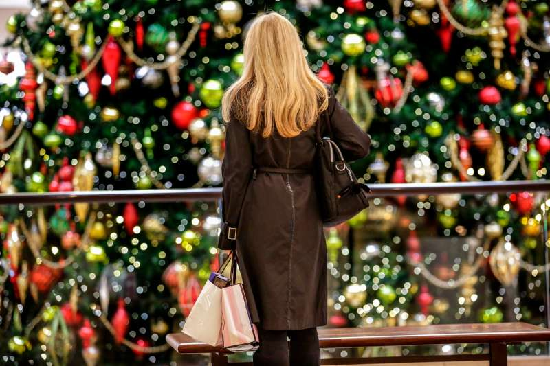 Kerry Reynolds shopping on Black Friday sales at South Coast Plaza looks at Christmas tree.