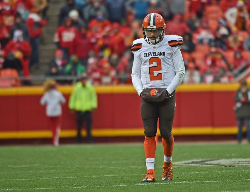 Quarterback Johnny Manziel #2 of the Cleveland Browns walks off the field, after a third down play against the Kansas City Chiefs during the first half on December 27, 2015 at Arrowhead Stadium in Kansas City, Missouri.