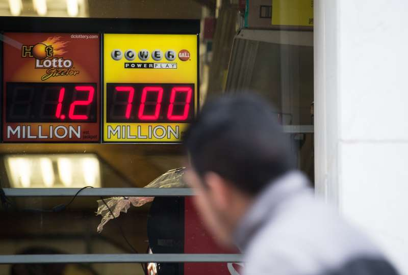 A sign in the window of a liquor store shows the Powerball lottery jackpot at $700 million in Washington, DC, on January 7, 2016.