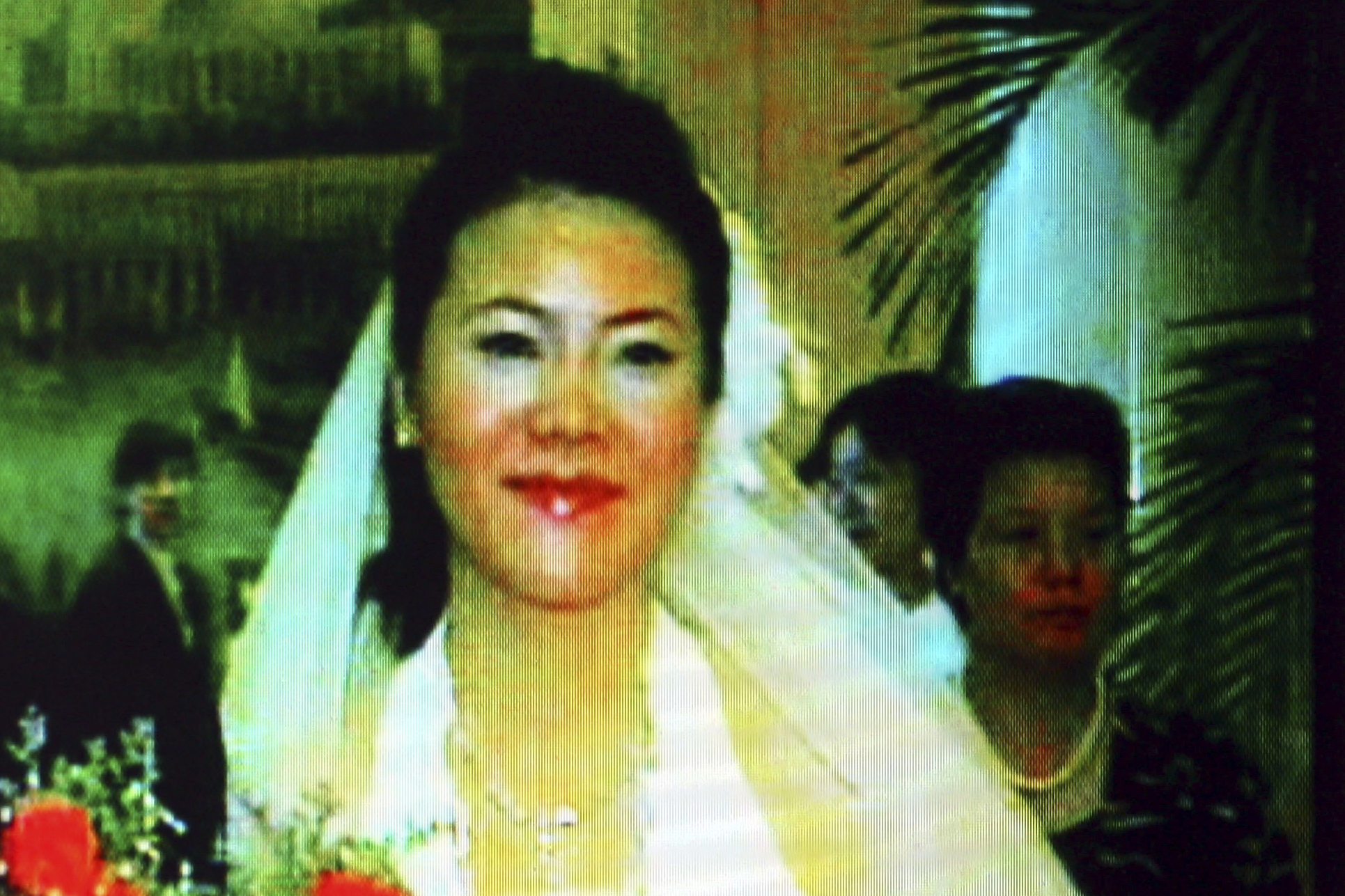 Video screen shot taken on October 23, 2008 shows Yang Huiyan, right, a major shareholder of Country Garden and Chinese Mainlands richest woman, and her husband Chen Chong during their wedding ceremony in Foshan city, south Chinas Guangdong province, 2006.