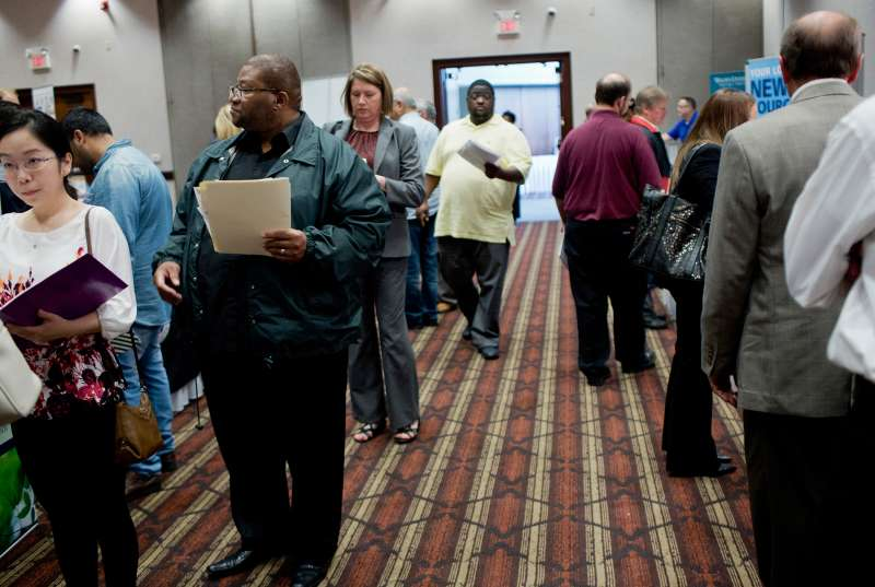 Job seekers attend a Job Fair Giant career fair in Sterling Heights, Michigan, on September 30, 2015.