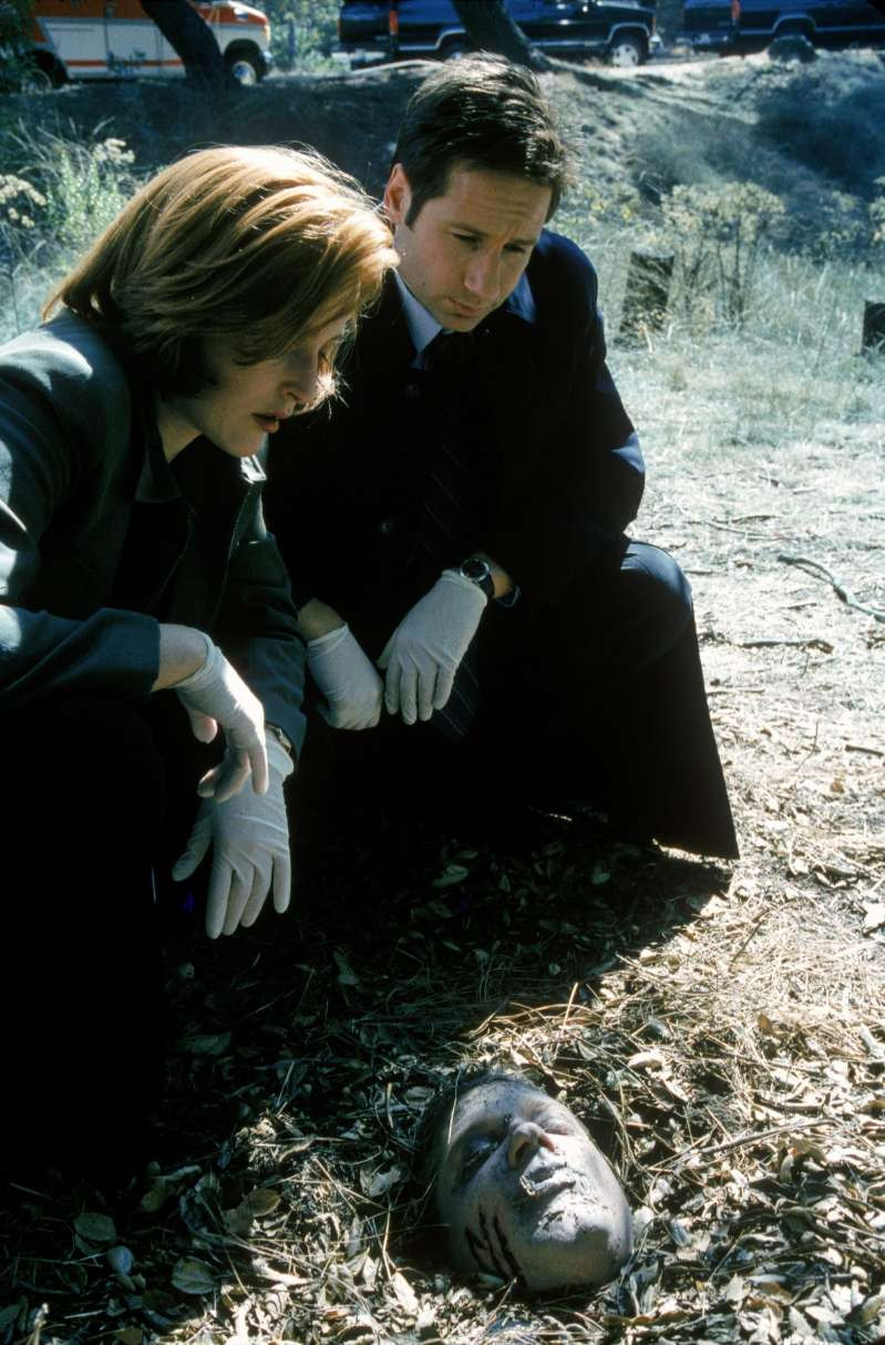 THE X-FILES - SEASON 7: Agent Dana Scully (Gillian Anderson, L) and agent Fox Mulder (David Duchovny, R) investigate a series of bizarre murders linked to the Millennium Group in the  Millennium  episode of THE X-FILES which originally aired on Sunday, Nov. 28, 1999 (9:00-10:00 PM ET/PT) on FOX. (Photo by FOX via Getty Images)