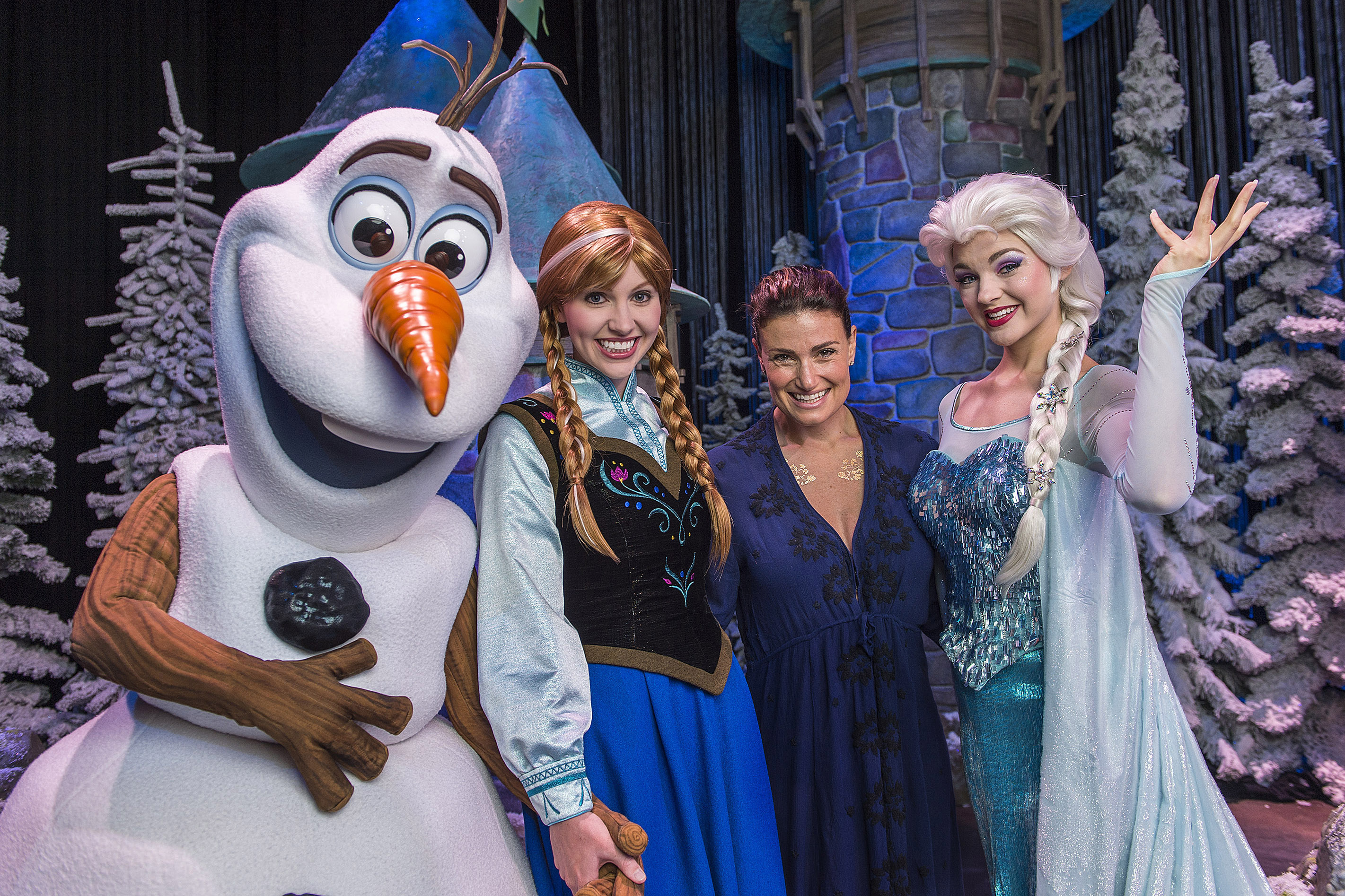 In this handout image provided by Disney Parks, Tony Award-winning actress and singer Idina Menzel poses on July 28, 2015 with Elsa, Anna and Olaf from Disney's  Frozen  during  Frozen Summer Fun  at Disney's Hollywood Studios theme park in Lake Buena Vista, Florida. Menzel took a break from her world tour to visit Walt Disney World Resort.
