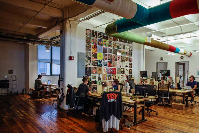 Employees work at Etsy headquarters in the Brooklyn borough of New York, U.S., on Tuesday, August 11, 2015