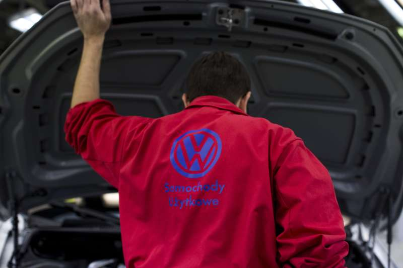 A worker lifts the hood to inspect the engine bay of a completed Volkswagen AG Caddy van during quality control checks at the end of the production line at VW plant in Poznan, Poland, on Wednesday, Dec. 22, 2015. Volkswagen's struggles mark a stark contrast to a buoyant recovery in Europe's auto market.