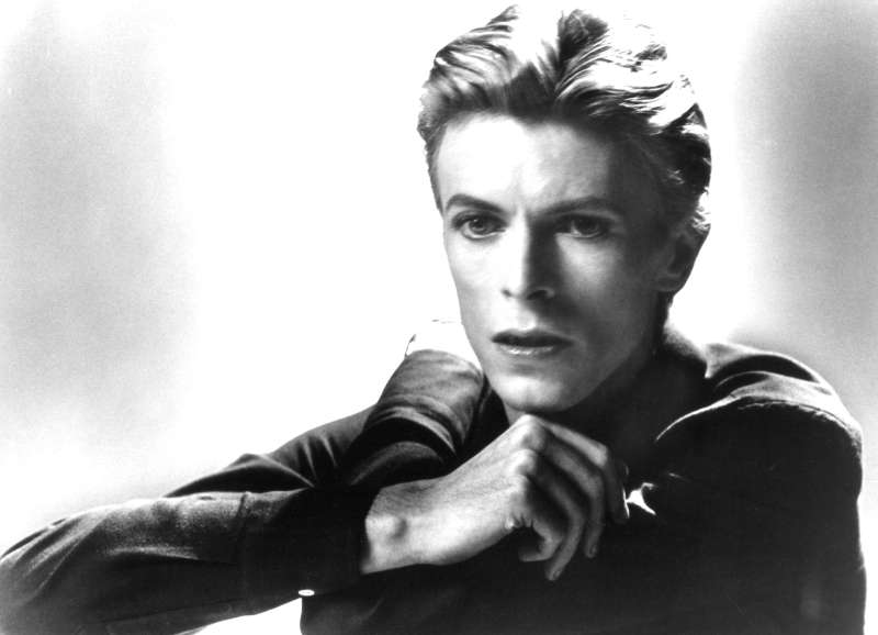 David Bowie poses for a portrait in 1976.