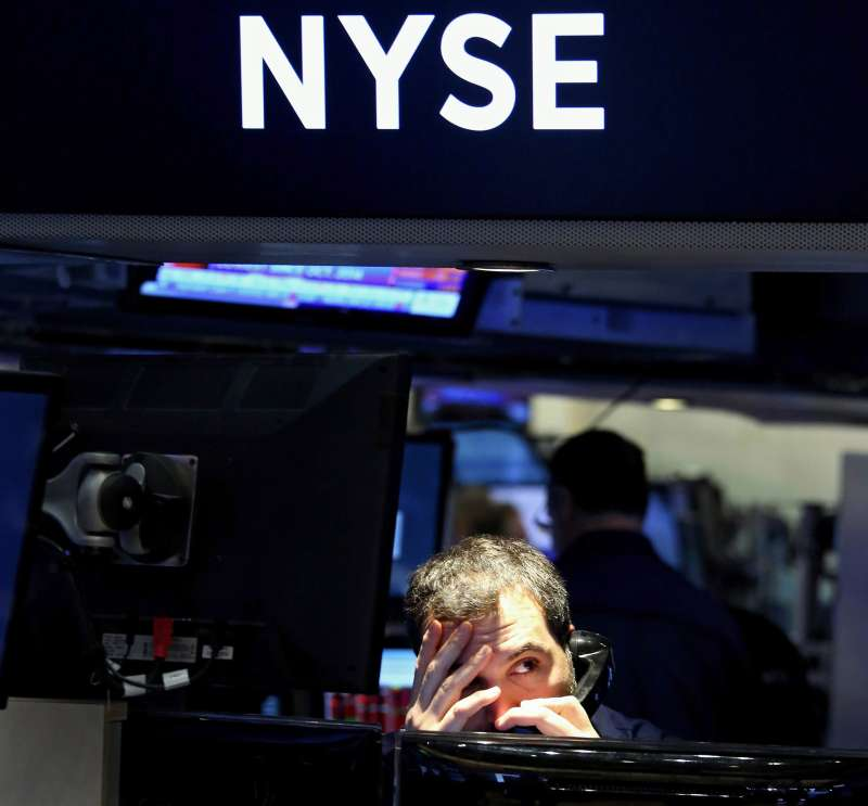 A trader works on the floor of the New York Stock Exchange at the start of the trading day in New York on Jan. 20, 2016.