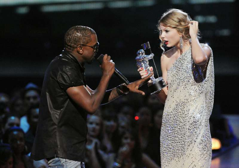 Kanye West jumps onstage as Taylor Swift accepts her award for the  Best Female Video  award during the 2009 MTV Video Music Awards.