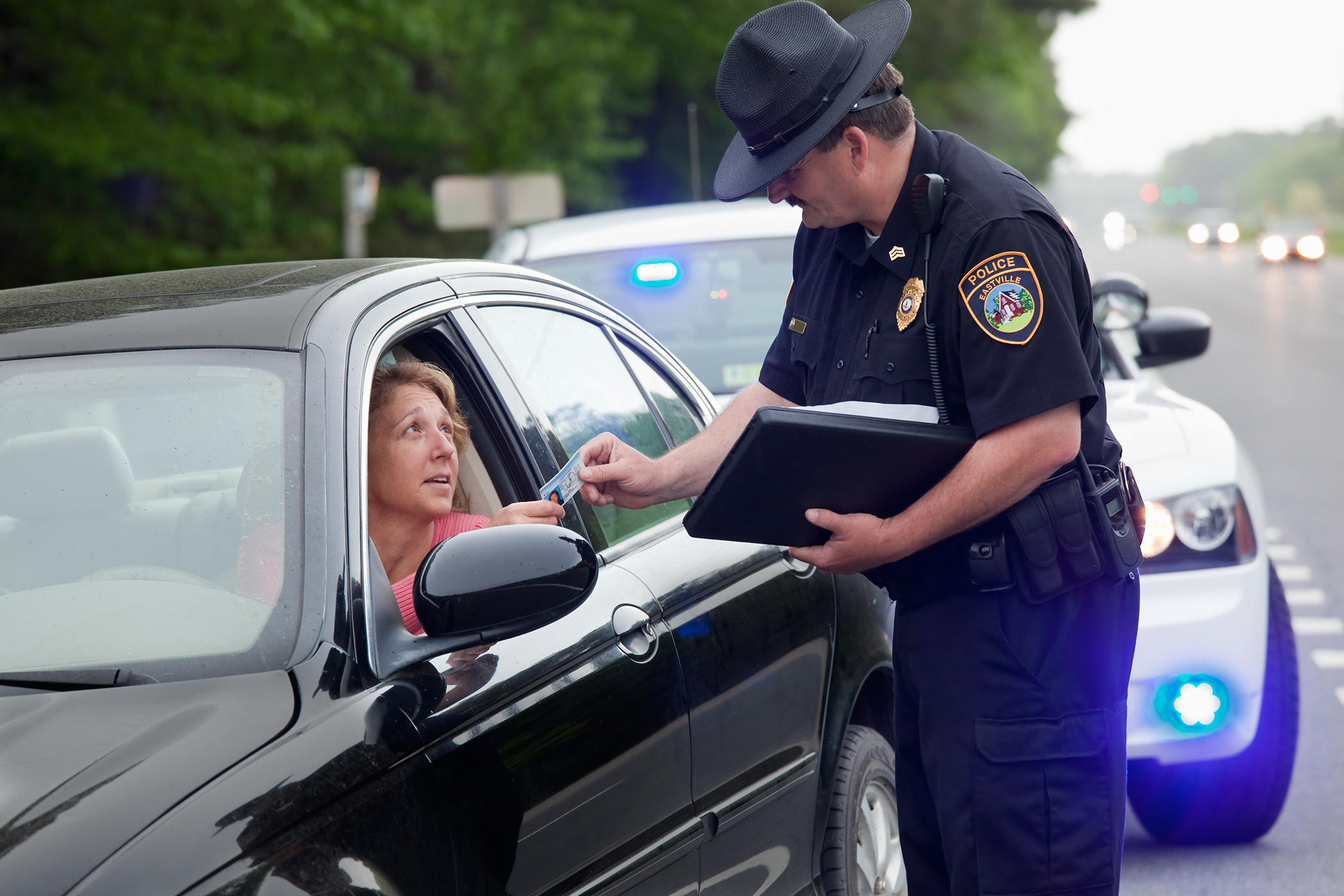 police officer handing out tickets