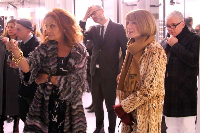 Designer Dian von Furstenberg talks with EIC of American Vogue Anna Wintour during the Diane von Furstenberg fashion presentation during New York Fashion Week at 440 W 14th St on February 14, 2016 in New York City.