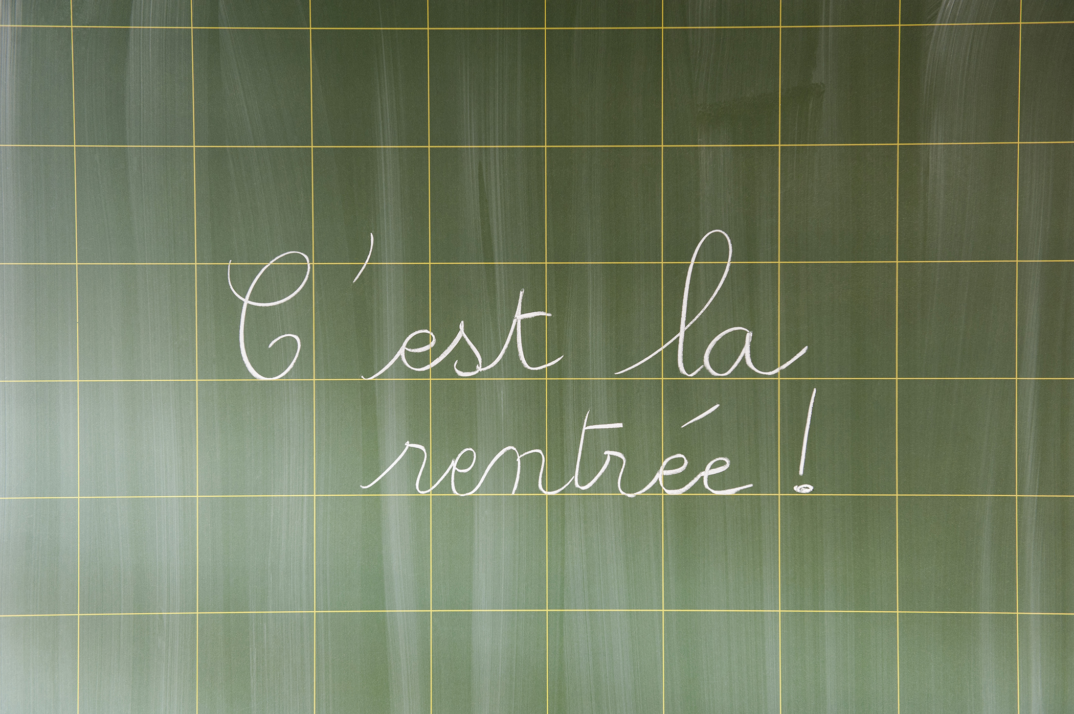 Back to School in French on chalkboard