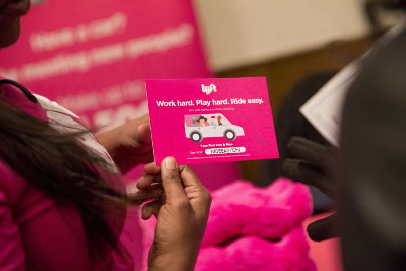 Rita McMiller, a recruiter with Lyft, left, speaks with a job seeker during a National Career Fairs job fair in Chicago, Illinois, U.S., on Thursday, Jan. 14, 2016.
