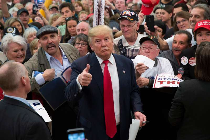 Republican presidential candidate Donald Trump gestures to photographers at a rally February 19, 2016 in Myrtle Beach, South Carolina. Trump is campaigning throughout South Carolina ahead of the state's primary.