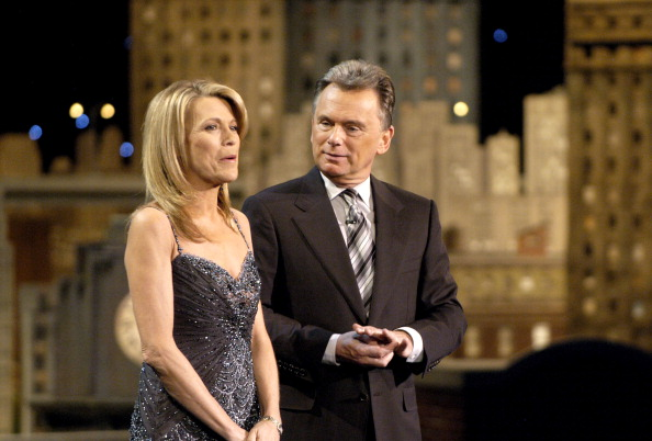 Wheel of Fortune hosts Vanna White (L) and Pat Sajak address the audience while taping episodes of the game show at Navy Pier on March 7, 2008 in Chicago, Illinois.