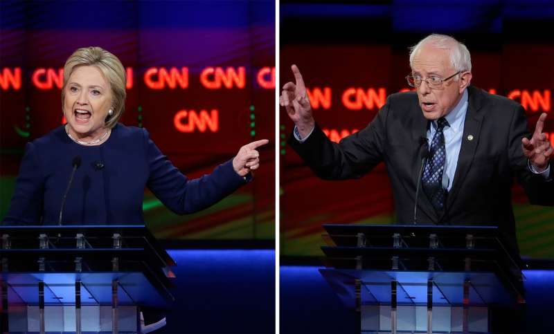 Democratic presidential candidates Hillary Clinton and Sen. Bernie Sanders, I-Vt., right, argues a point during a Democratic presidential primary debate at the University of Michigan-Flint, Sunday, March 6, 2016, in Flint, Michigan.