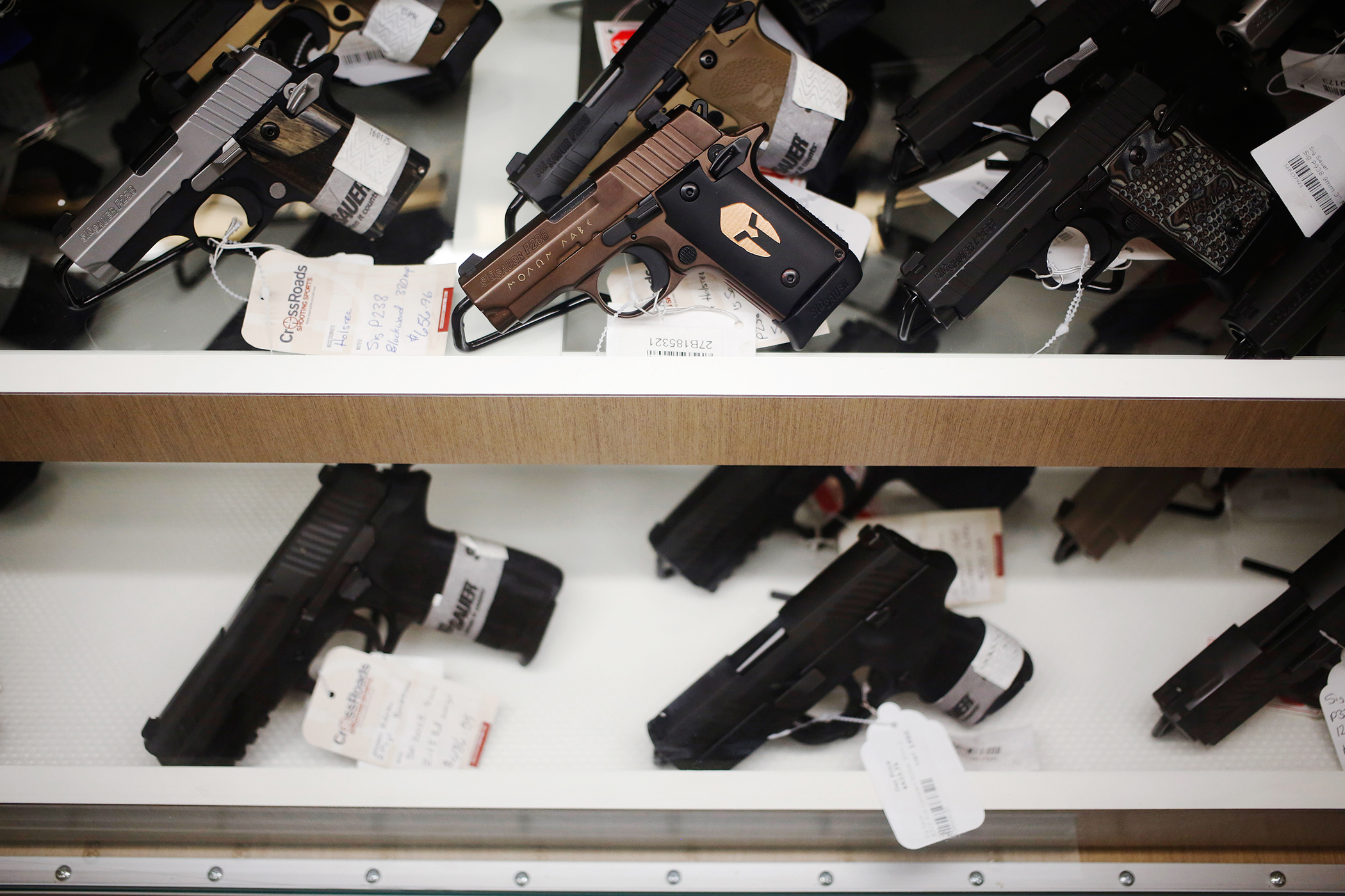 Handguns manufactured by SIG Sauer GmbH are displayed for sale during a campaign event for Donald Trump, president and chief executive of Trump Organization Inc. and 2016 Republican presidential candidate, at CrossRoads Shooting Sports in Johnston, Iowa, U.S., on January 30, 2016.