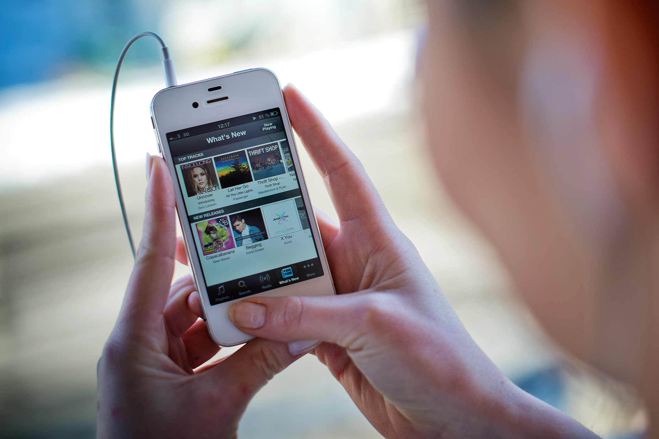 This photo shows a woman as she uses the iPhone application of Swedish music streaming service Spotify on March 7, 2013.