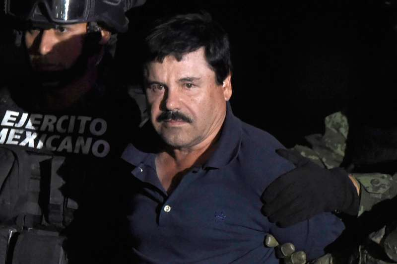 Drug kingpin Joaquin  El Chapo  Guzman is escorted to a helicopter at Mexico City's airport on January 8, 2016 following his recapture during an intense military operation in Los Mochis, in Sinaloa State. Mexican marines recaptured fugitive drug kingpin Joaquin  El Chapo  Guzman in the northwest of the country, six months after his spectacular prison break embarrassed authorities.