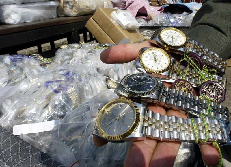 BANGKOK, THAILAND:  An unidentified Thai customs officer shows counterfeit Rolex watches confiscated in different raids during a display at the customs house in Bangkok.