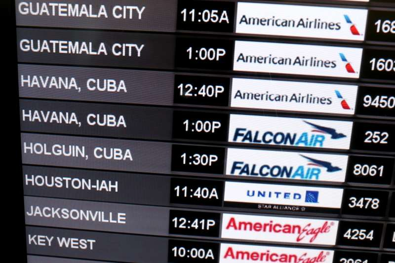 A sign shows the departure times for flights to Cuba at Miami International Airport on December 19, 2014 in Miami, Florida.