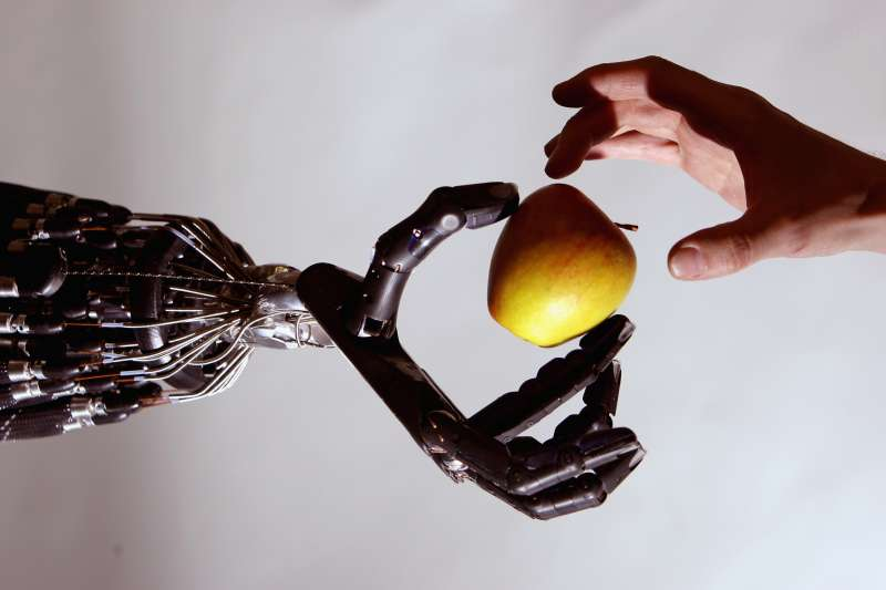 LONDON - MAY 06:  The Shadow Robot company's dextrous hand robot holds an Apple at the Streetwise Robots event held at the Science Museum's Dana Centre on May 6, 2008 in London, England. T
