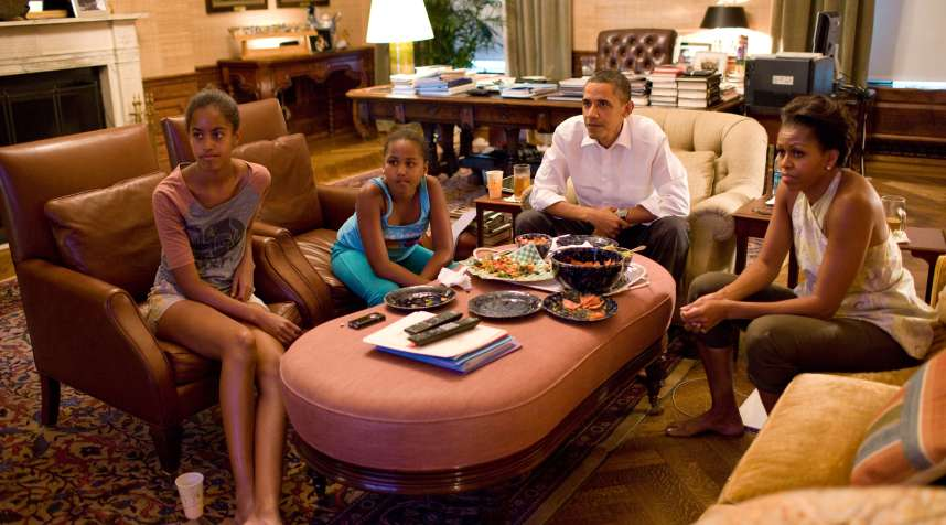 The Obama family watching World Cup soccer.