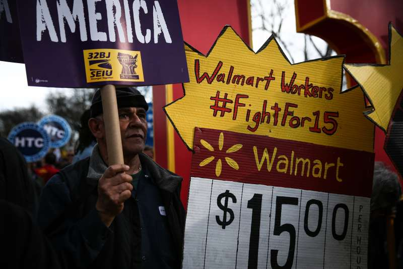 NEW YORK, UNITED STATES - APRIL 15: A national movement 'Fight For $15' including workers and labor unions march to raise the minimum wage to $15/hour, at Colombus Square.