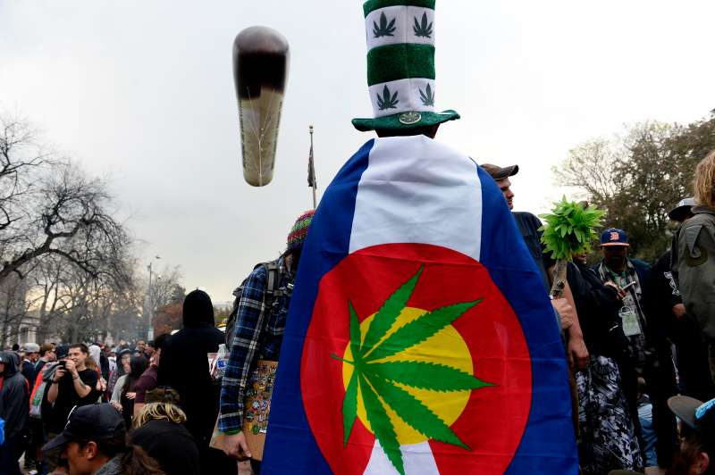 Pot smokers partake in smoking marijuana at exactly 4:20 during the annual 420 celebration in Lincoln Park near the State Capitol in Denver, Colorado  on April 20, 2015.