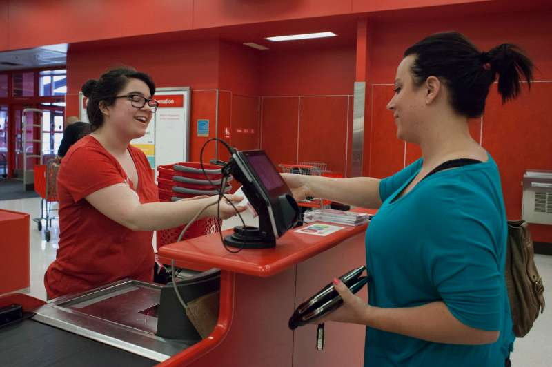 An employee hand a receipt to a customer at a Target Corp. retail location in Seattle, Washington, U.S., Ryder/Bloomberg