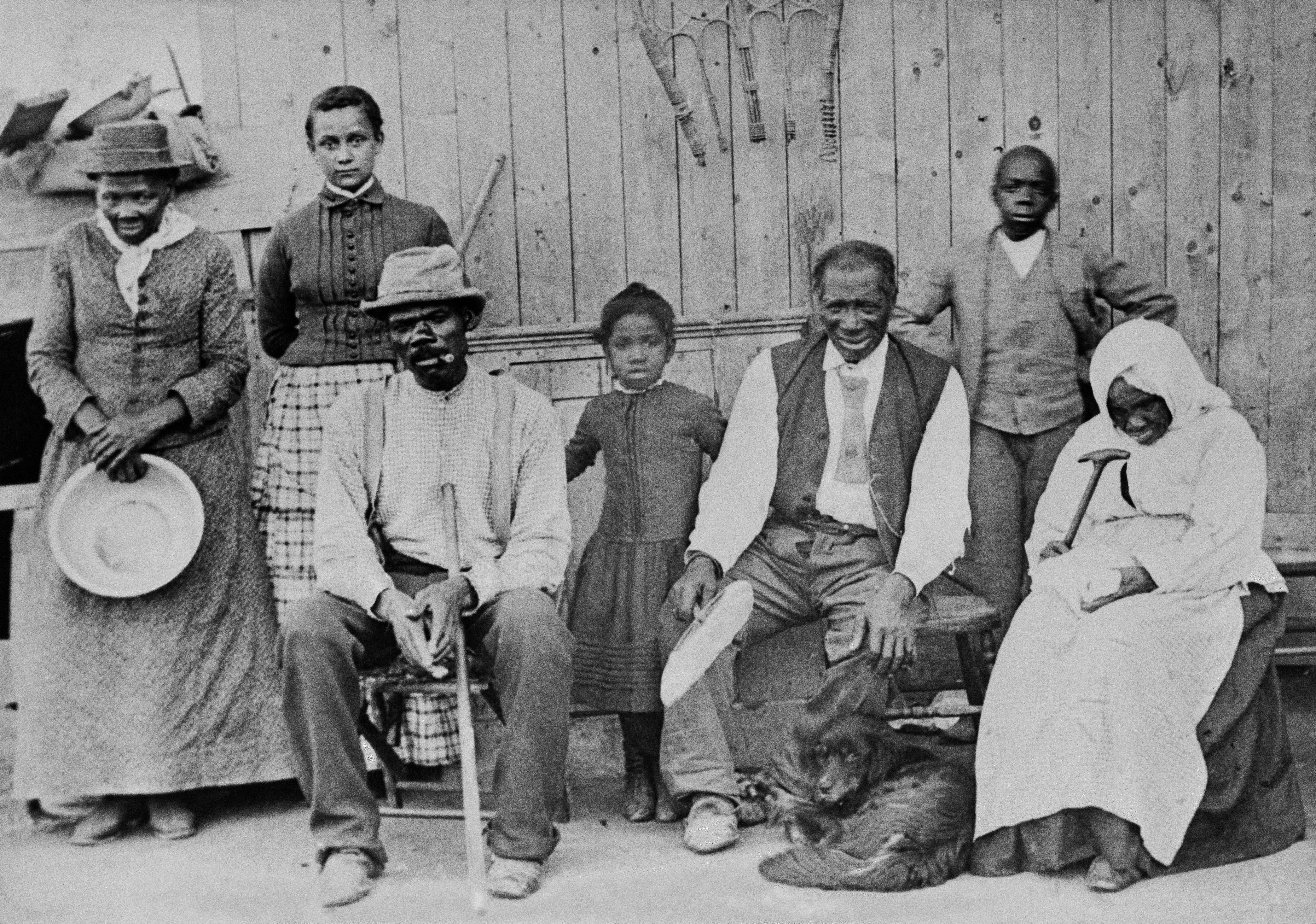 American abolitionist (extreme left, holding a pan), photographed with a group of slaves she helped escape.