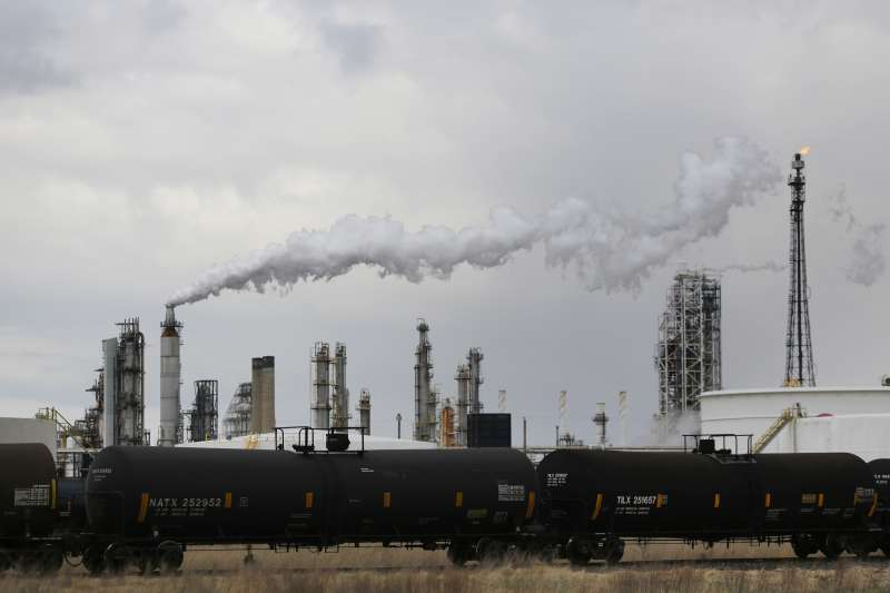 Railroad tanker cars sit parked outside the Paulsboro Refining Company oil refinery in Paulsboro, New Jersey, U.S., on Friday, April 8, 2016.
