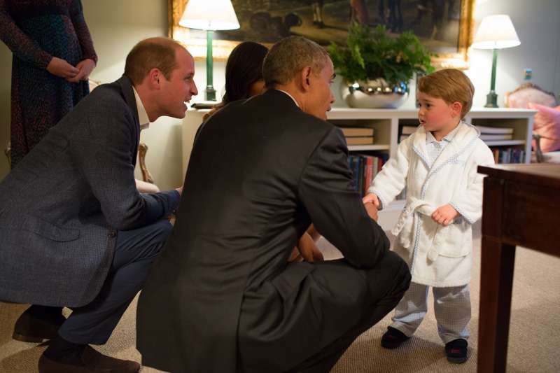 Prince George meets President Obama and First Lady Michelle Obama in April 2016. The robe that he wore later sold out.