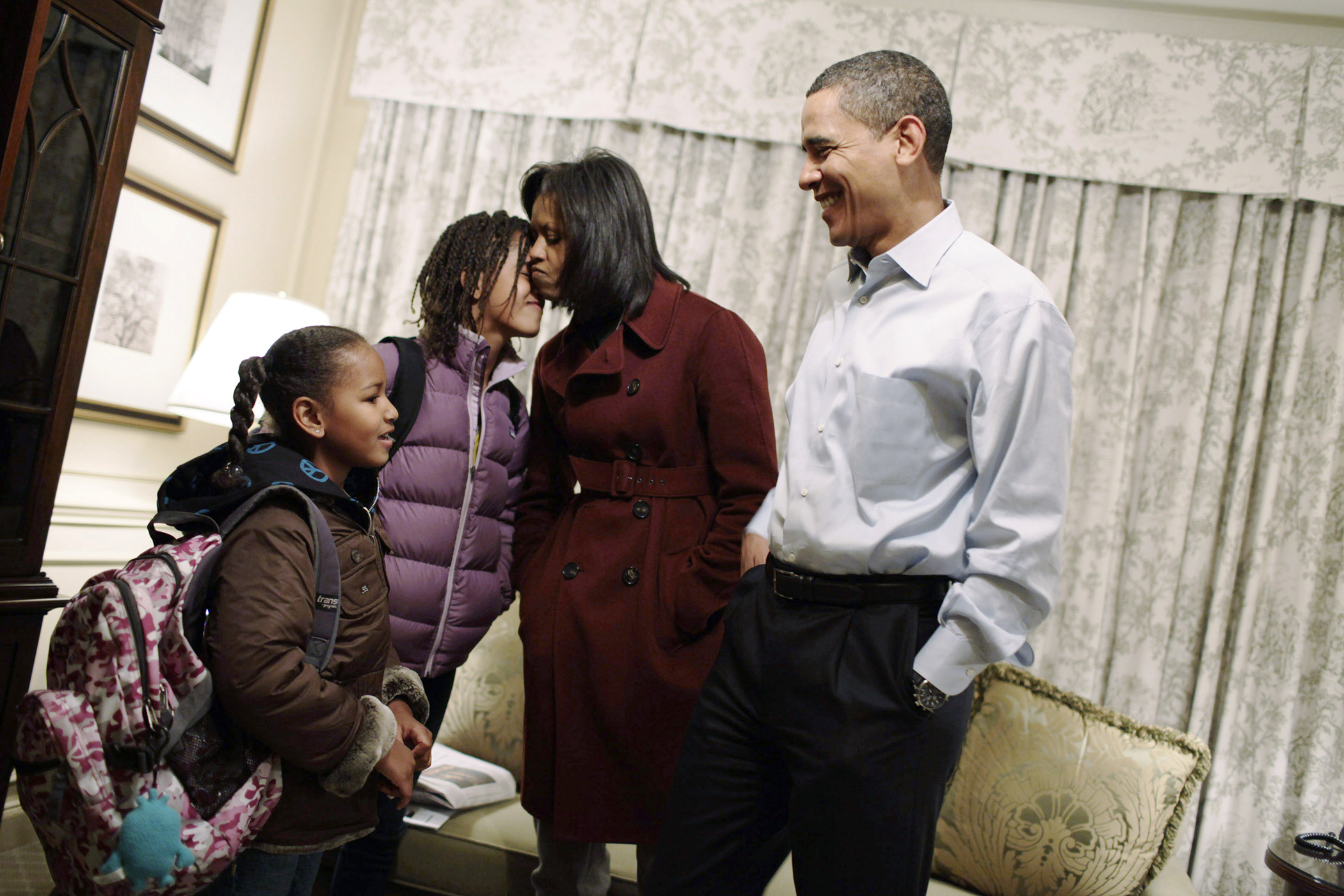 U.S. President elect Barack Obama and Michelle Obama get their daughters Sasha (L) and Malia (second from left) ready for their first day of school at Sidwell Friends in Washington January 5, 2009. The Obama family is staying at the Hay Adams Hotel in Washington until they move to Blair House, and then to the White House on January 20, 2009.