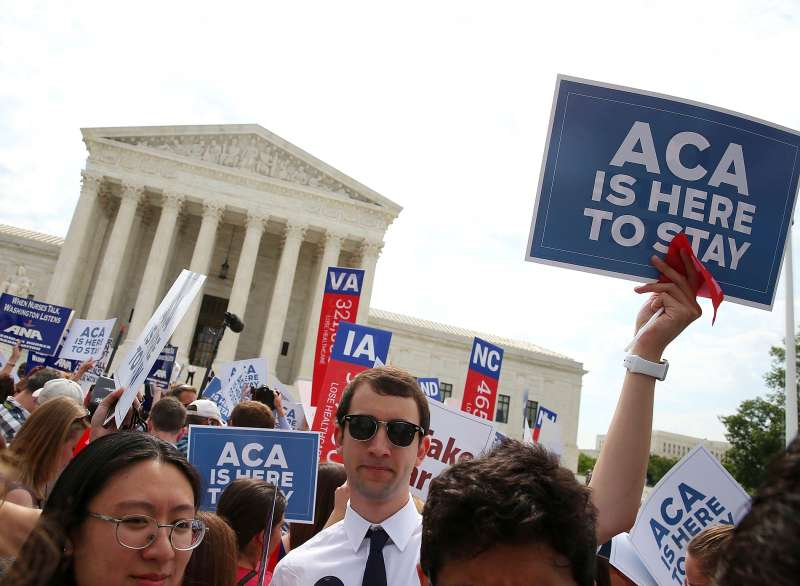 People celebrate in front of the US Supreme Court after the ruling was announced on the Affordable Care Act. June 25, 2015 in Washington, DC. The high court ruled that the Affordable Care Act may provide nationwide tax subsidies to help poor and middle-class people buy health insurance.