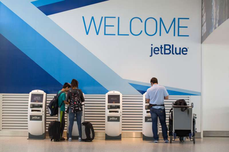 Travelers check in at JetBlue Airways Corp.'s Terminal 5 at John F. Kennedy International Airport (JFK) airport in New York, U.S.