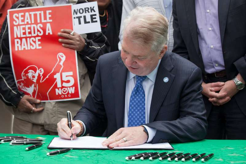 Seattle Mayor Ed Murray signed a bill that raises the city's minimum wage to $15 an hour on June 3, 2014 in Seattle, Washington. The bill passed unanimously in a Seattle city council meeting in June 2, 2016.