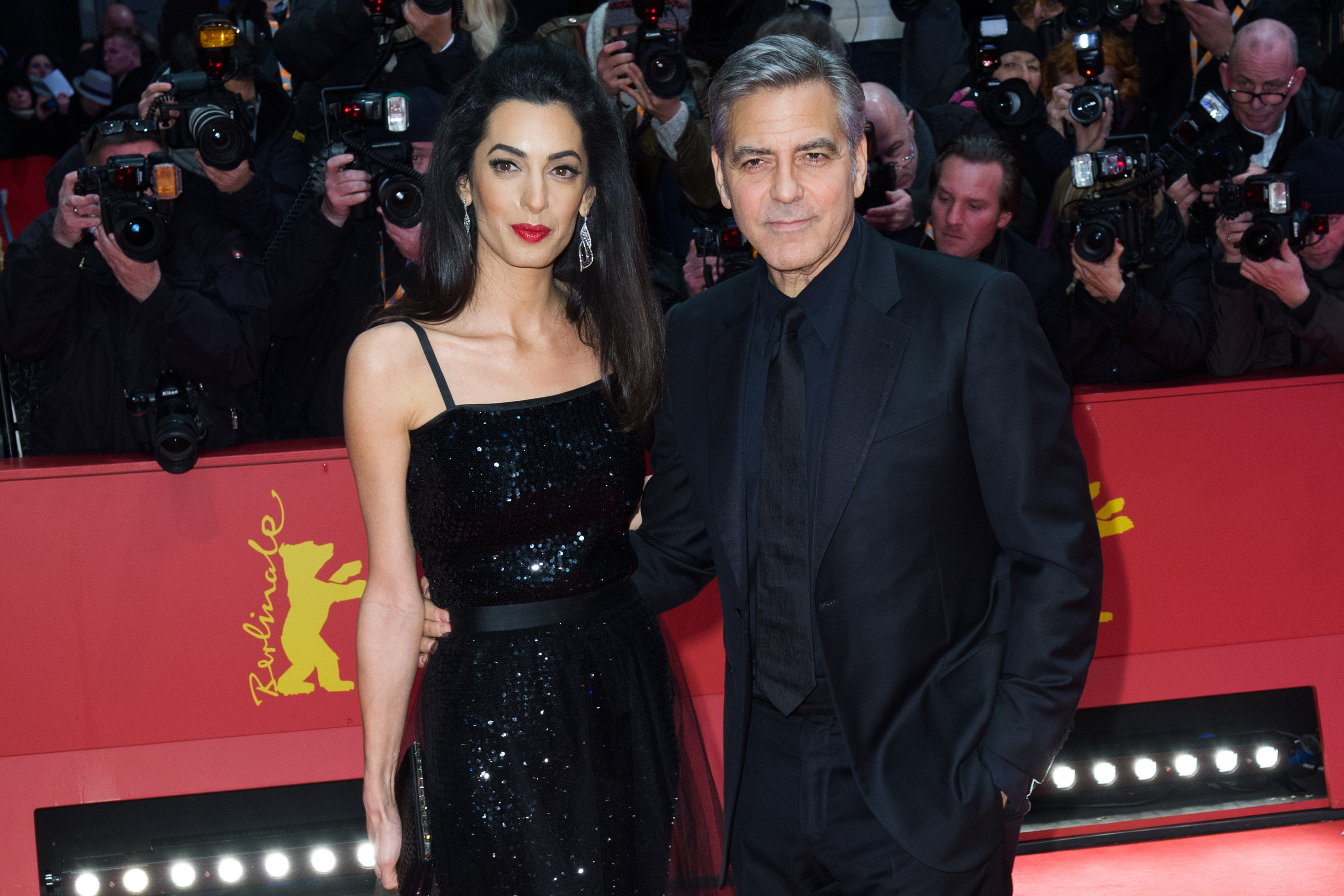 George Clooney and his wife Amal attend the 'Hail, Caesar!' premiere during the 66th Berlinale International Film Festival Berlin at Berlinale Palace on February 11, 2016 in Berlin, Germany.
