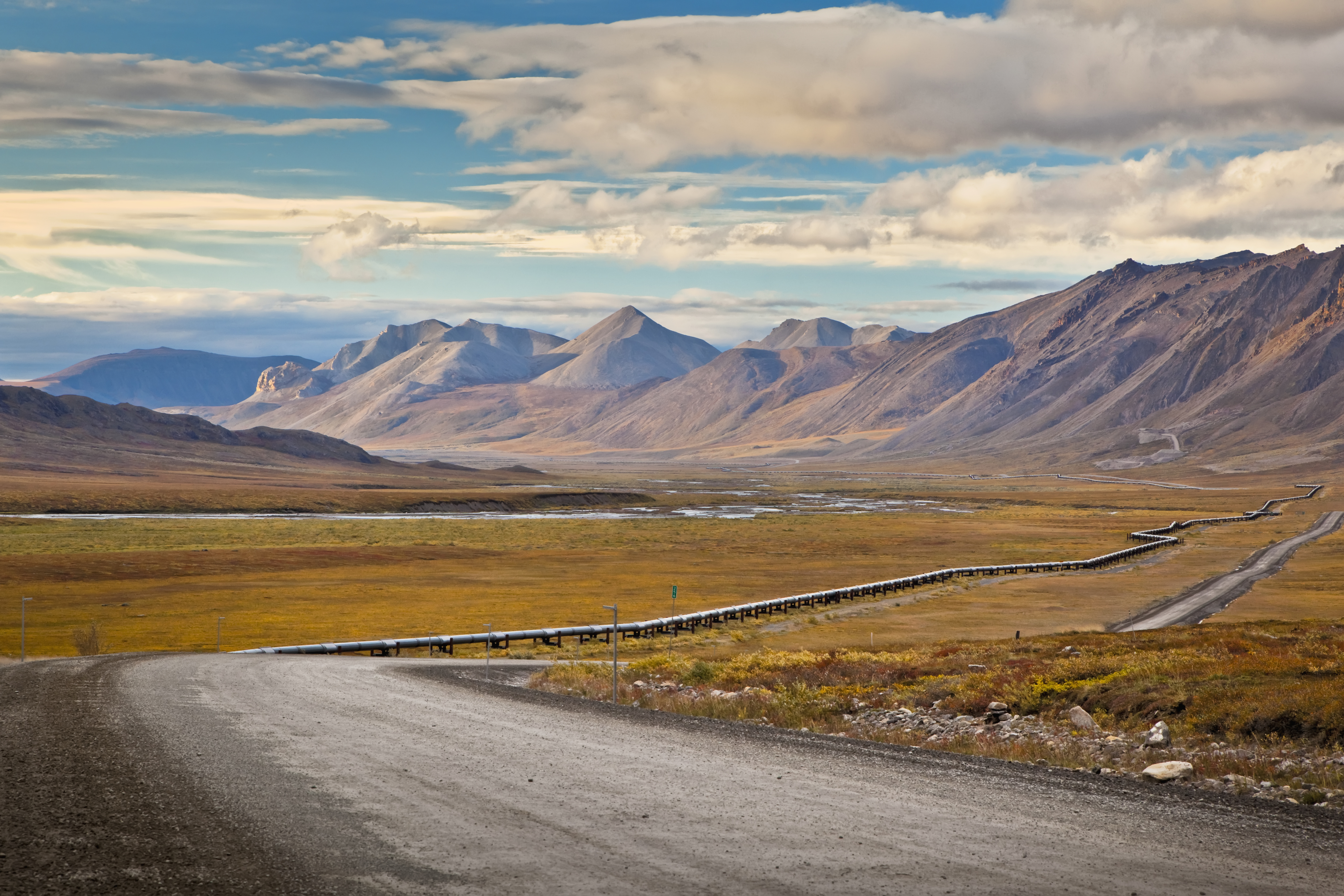Scenic view of the Trans-Alaska Pipeline along the Dalton Highway and the Brooks Range in the background, ANWR, Arctic Alaska, Autumn