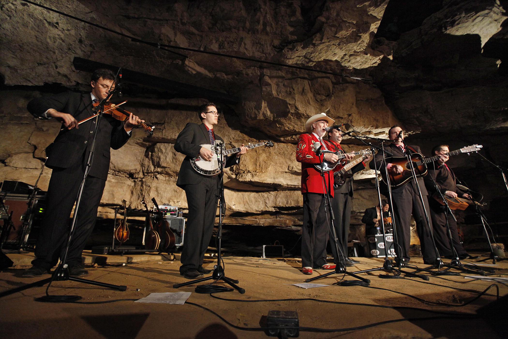 In this July 26, 2011 photo, Doyle Lawson, center, and Quicksilver perform in the Volcano Room at Cumberland Caverns, 333 feet below ground, in McMinnville, Tenn. The natural ampitheater is where the Bluegrass Underground radio show is broadcast from once a month.