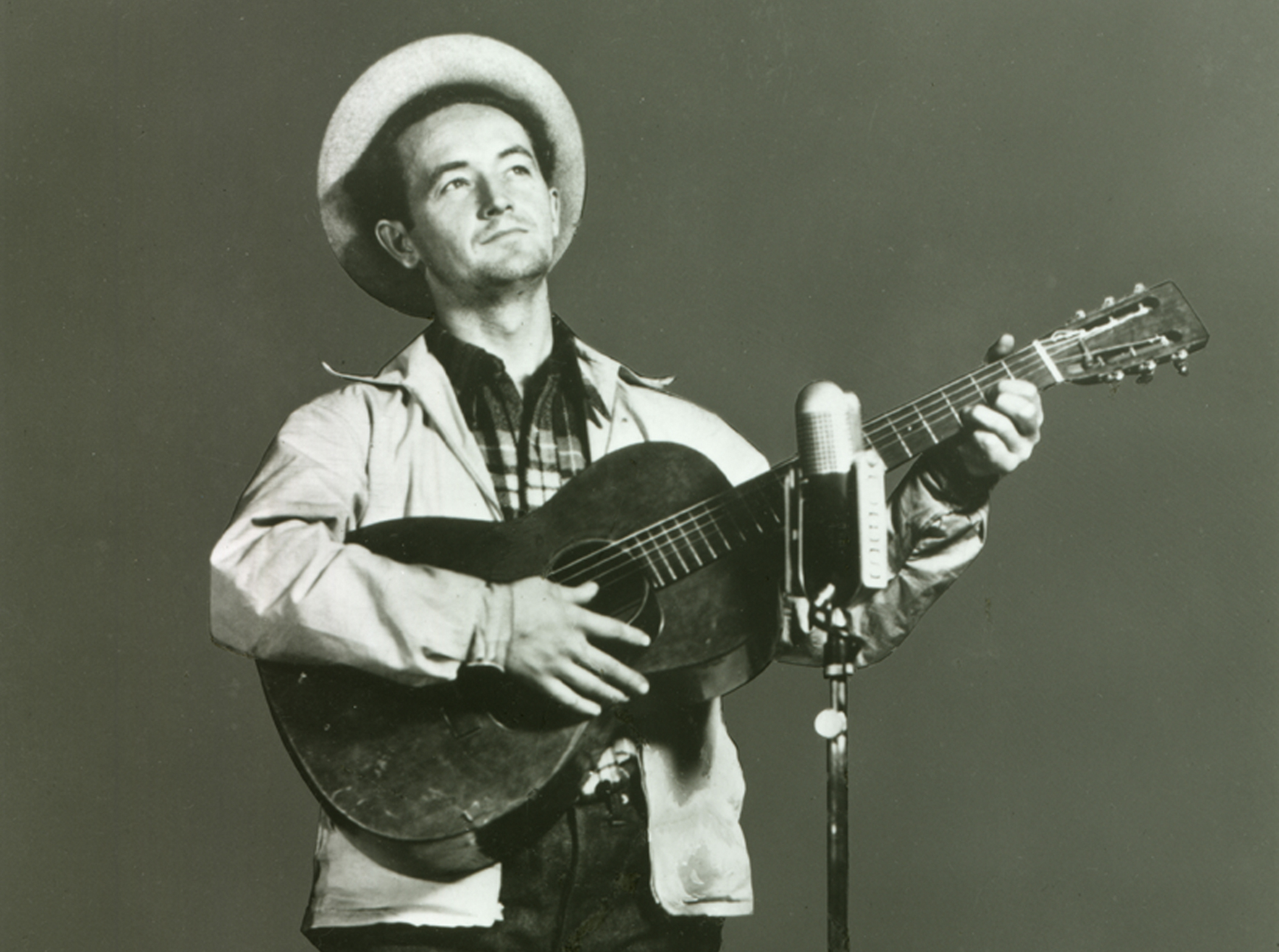 """Woody Guthrie performing on """"Back Where I Come From"""" radio show, WABC-CBS. New York City, 1940."""
