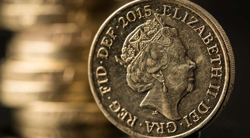 A British one pound sterling coin stands in front of a stack of one pound sterling coins in this arranged photograph in Guildford, U.K., on Monday, June 13, 2016. Sterling swung on Monday as anxiety about Britains referendum on staying or leaving the European Union continued to build.
