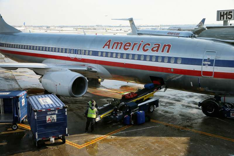Luggage is loaded on to an American Airlines jet as it is prepared for a flight at O'Hare Airport.