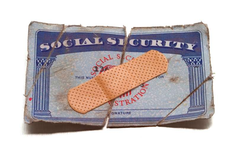 ripped, dirty social security card with bandage