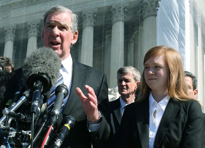 Abigail Fisher stands beside her attorney outside the U.S. Supreme Court in, 2012, when her case first was heard by the high court. On Thursday, the court ruled against Fisher, saying the university's consideration of race in admissions is constitutional.  (Photo by Mark Wilson/Getty Images)