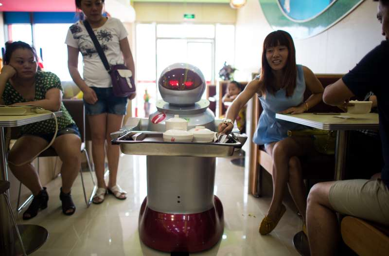 It's more teatime than Terminator -- a restaurant in China is using more than a dozen robots to cook and deliver food.