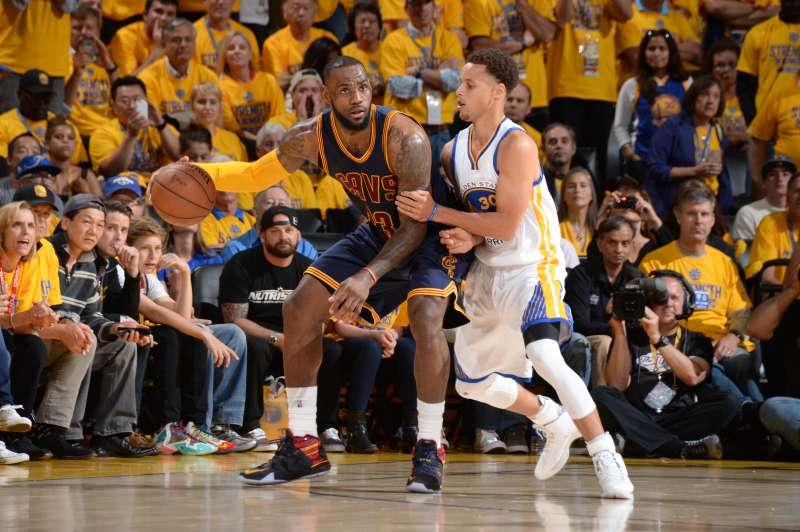 LeBron James of the Cleveland Cavaliers handles the basketball against Stephen Curry of the Golden State Warriors during Game Five of the 2015 NBA Finals.