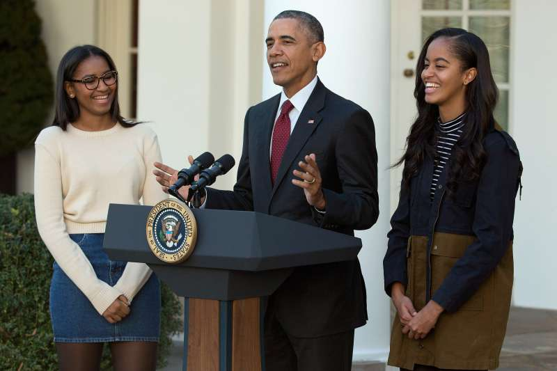 President Obama with Sasha (L) and Malia.