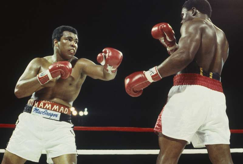 NASSAU - DECEMBER 11: Muhammad Ali throws a left hook and misses Trevor Berbick at the Queen Elizabeth Sports Centre on December 11, 1981 in Nassau, Bahamas.  Berbick defeated Ali in the tenth round. (Focus on Sport/Getty Images)