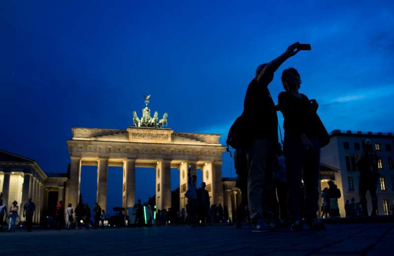 Tourists in front of the Brandenburg Gate in Berlin