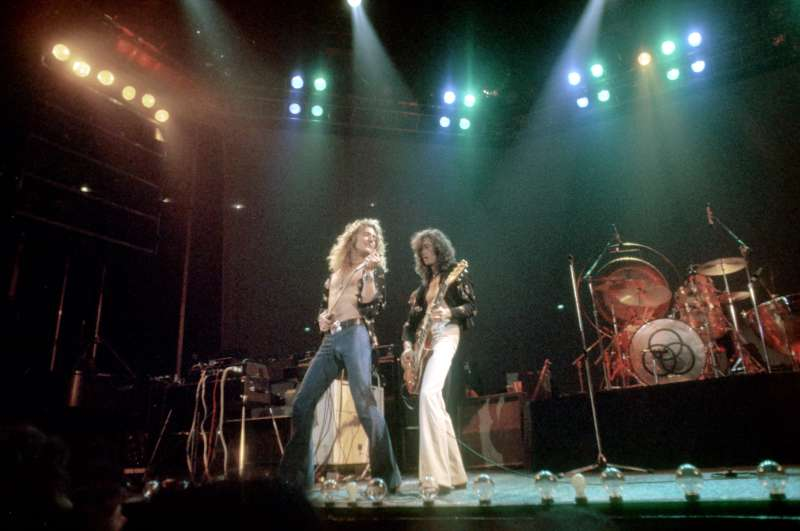 Singer Robert Plant and guitarist Jimmy Page of the rock band  Led Zeppelin  perform onstage at the Forum on June 26, 1977 in Los Angeles, California.